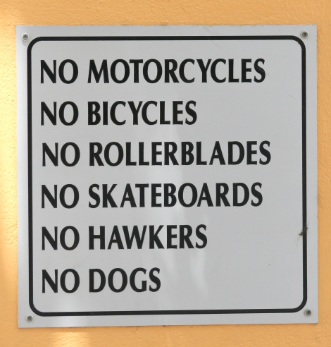 sign saying no bikes, rollerblades, dogs, close up outdoors