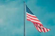 American flag fluttering in sky http://barnimages.com/